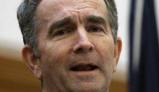 Virginia Gov. Ralph Northam talks about security plans for Lobby Day at the Capitol Monday, Jan. 20, 2020, when large crowds are expected to arrive at Capitol Square, during a press conference at the Patrick Henry Building in Richmond, Wednesday, Jan. 15, 2020. (Bob Brown/Richmond Times-Dispatch via AP)