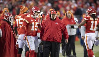 Kansas City Chiefs quarterback Patrick Mahomes (15) and head coach Andy Reid during an NFL divisional playoff football game against the Houston Texans in Kansas City, Mo., Sunday, Jan. 12, 2020. (AP Photo/Colin E. Braley) **FILE**