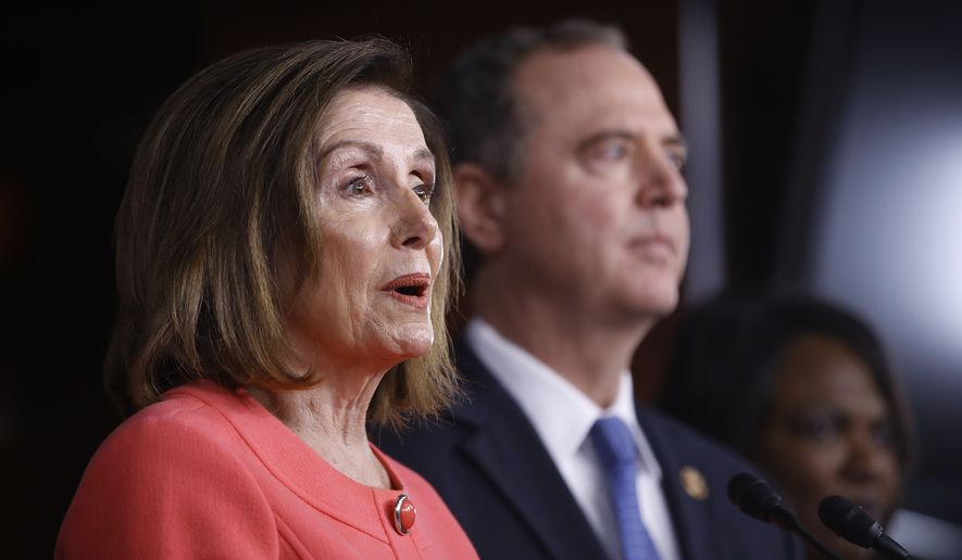 House Speaker Nancy Pelosi of Calif., joined by House Intelligence Committee Chairman Adam Schiff, D-Calif., speaks during a news conference to announce impeachment managers on Capitol Hill in Washington, Wednesday, Jan. 15, 2020. (AP Photo/Matt Rourke)