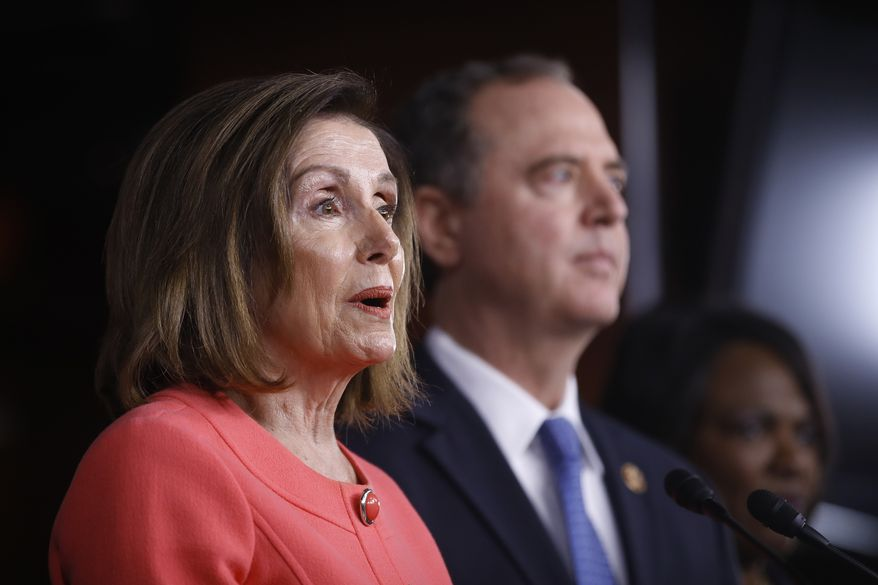 House Speaker Nancy Pelosi of Calif., joined by House Intelligence Committee Chairman Adam Schiff, D-Calif., speaks during a news conference to announce impeachment managers on Capitol Hill in Washington, Wednesday, Jan. 15, 2020. (AP Photo/Matt Rourke) ** FILE **