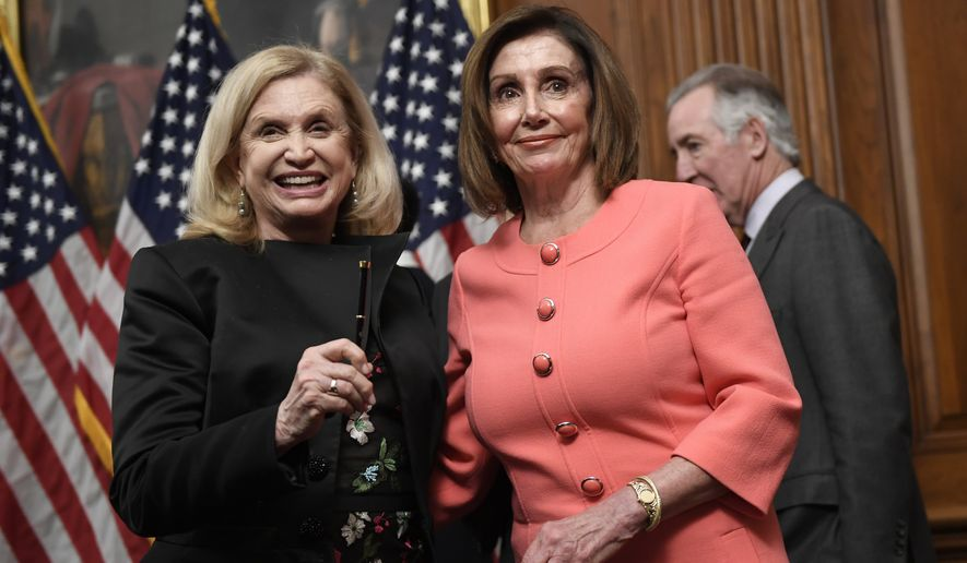 House Speaker Nancy Pelosi of Calif., left, stands with House Oversight and Government Reform Committee Chair Rep. Carolyn Maloney, D-N.Y., left, after she signed the resolution to transmit the two articles of impeachment against President Donald Trump to the Senate for trial on Capitol Hill in Washington, Wednesday, Jan. 15, 2020. The two articles of impeachment against Trump are for abuse of power and obstruction of Congress. (AP Photo/Susan Walsh)