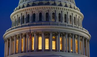The Capitol is seen in Washington, early Wednesday, Jan. 15, 2020, as the House is set to vote to send the articles of impeachment against President Donald Trump to the Senate for a landmark trial on whether the charges of abuse of power and obstruction of Congress are grounds for his removal. (AP Photo/J. Scott Applewhite)