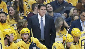 In this Oct. 8, 2019, file photo, Nashville Predators head coach Peter Laviolette watches the action in an NHL hockey game against the San Jose Sharks, in Nashville, Tenn. (AP Photo/Mark Humphrey, File)