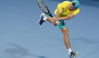 Alex de Minaur of Australia plays a shot against Rafael Nadal of Spain during their ATP Cup tennis match in Sydney, Saturday, Jan. 11, 2020. (AP Photo/Steve Christo)