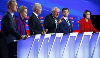 Democratic presidential candidate Sen. Bernie Sanders, I-Vt.,, center, speaks as fellow candidates businessman Tom Steyer, from left, Sen. Elizabeth Warren, D-Mass., former Vice President Joe Biden, former South Bend Mayor Pete Buttigieg and Sen. Amy Klobuchar, D-Minn. listen, Tuesday, Jan. 14, 2020, during a Democratic presidential primary debate hosted by CNN and the Des Moines Register in Des Moines, Iowa. (AP Photo/Patrick Semansky)