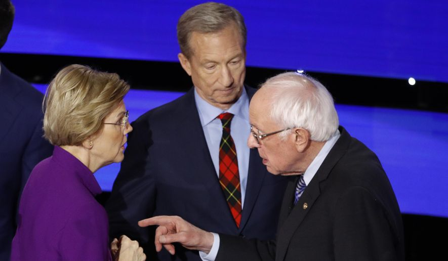 Democratic presidential candidate Sen. Elizabeth Warren, D-Mass., left and Sen. Bernie Sanders, I-Vt., talk Tuesday, Jan. 14, 2020, after a Democratic presidential primary debate hosted by CNN and the Des Moines Register in Des Moines, Iowa. Candidate businessman Tom Steyer looks on. (AP Photo/Patrick Semansky)
