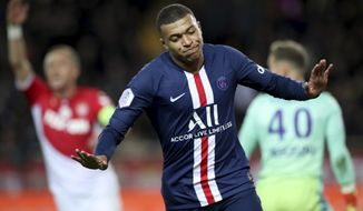 PSG's Kylian Mbappe celebrates after scoring his side's opening goal during the French League One soccer match between Monaco and Paris Saint-Germain at the Louis II stadium in Monaco, France, Wednesday, Jan. 15, 2019. (AP Photo/Daniel Cole)