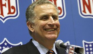 FILE - In this March 8, 2006, file photo, then-NFL Commissioner Paul Tagliabue smiles while addressing the media at an NFL owners meeting in Grapevine, Texas. Former NFL Commissioner Paul Tagliabue has made the Pro Football Hall of Fame in his fifth attempt. Tagliabue and former New York Giants general manager George Young made it as contributors. Ex-Dallas Cowboys safety Cliff Harris and former Cleveland receiver Mac Speedie completed the centennial class announced Wednesday, Jan. 15, 2020. The class of 10 senior candidates, three contributors and two coaches are part of the hall's celebration of the NFL's 100th season. (AP Photo/D.J. Peters) ** FILE **