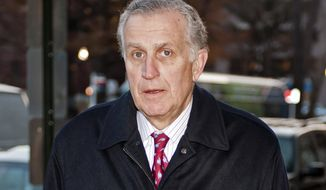 FILE - In this Nov. 30, 2012, file photo, former NFL commissioner Paul Tagliabue arrives at an attorney's office in Washington. Former NFL Commissioner Paul Tagliabue has made the Pro Football Hall of Fame in his fifth attempt.Tagliabue and former New York Giants general manager George Young made it as contributors. Ex-Dallas Cowboys safety Cliff Harris and former Cleveland receiver Mac Speedie completed the centennial class announced Wednesday, Jan. 15, 2020. The class of 10 senior candidates, three contributors and two coaches are part of the hall's celebration of the NFL's 100th season. (AP Photo/Cliff Owen, File)