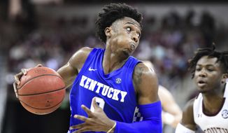 Kentucky guard Ashton Hagans (0) drives to the basket during the first half of the team's NCAA college basketball game against South Carolina on Wednesday, Jan. 15, 2020, in Columbia, S.C. (AP Photo/Sean Rayford)