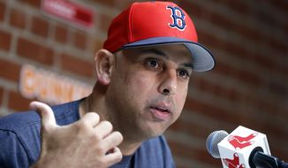 In this Sept. 9, 2019, file photo, Boston Red Sox manager Alex Cora talks about the dismissal of president of baseball operations Dave Dombrowski, during a news conference before the team's baseball game against the New York Yankees in Boston. Cora was fired by the Red Sox on Tuesday, Jan. 14, 2020, a day after baseball Commissioner Rob Manfred implicated him in the sport's sign-stealing scandal. (AP Photo/Michael Dwyer, File) **FILE**