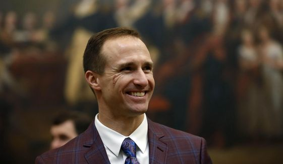 New Orleans Saints NFL football quarterback Drew Brees gets a tour of the rotunda at the Capitol, in Washington, Wednesday, Jan. 15, 2020, before a Congressional Gold Medal ceremony for former NFL player Steve Gleason. (AP Photo/Julio Cortez)  **FILE**
