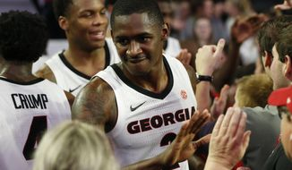 Georgia's Jordan Harris (2) celebrates with fans after the team's NCAA college basketball game against Tennessee on Wednesday, Jan. 15, 2020, in Athens, Ga. (Joshua L. Jones/Athens Banner-Herald via AP)
