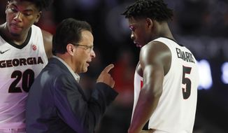 Georgia coach Tom Crean speaks with Georgia's Anthony Edwards (5) during the team's NCAA college basketball game against Tennessee on Wednesday, Jan. 15, 2020, in Athens, Ga. (Joshua L. Jones/Athens Banner-Herald via AP)