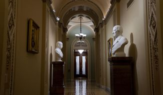 The entrance to the Senate cloakroom at the Capitol is seen in Washington, early Wednesday, Jan. 15, 2020, as the House is set to vote to send the articles of impeachment against President Donald Trump to the Senate for a landmark trial on whether the charges of abuse of power and obstruction of Congress are grounds for his removal. (AP Photo/J. Scott Applewhite)