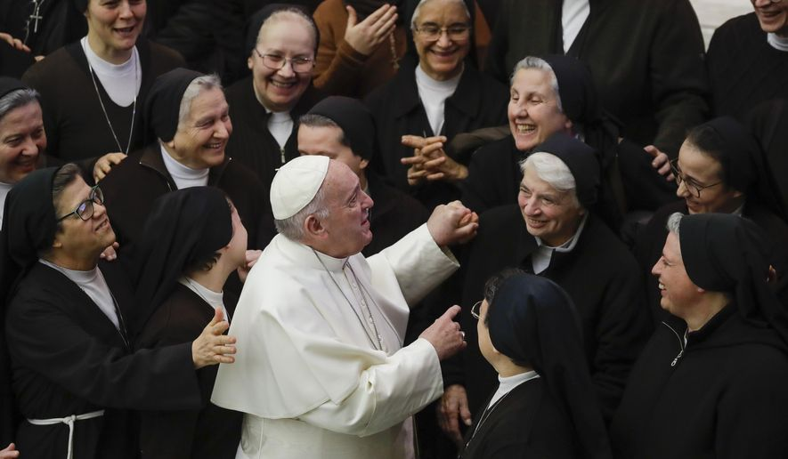 Pope Francis greets a group of nuns during his weekly general audience, in Paul VI Hall at the Vatican, Wednesday, Jan. 15, 2020. (AP Photo/Alessandra Tarantino)