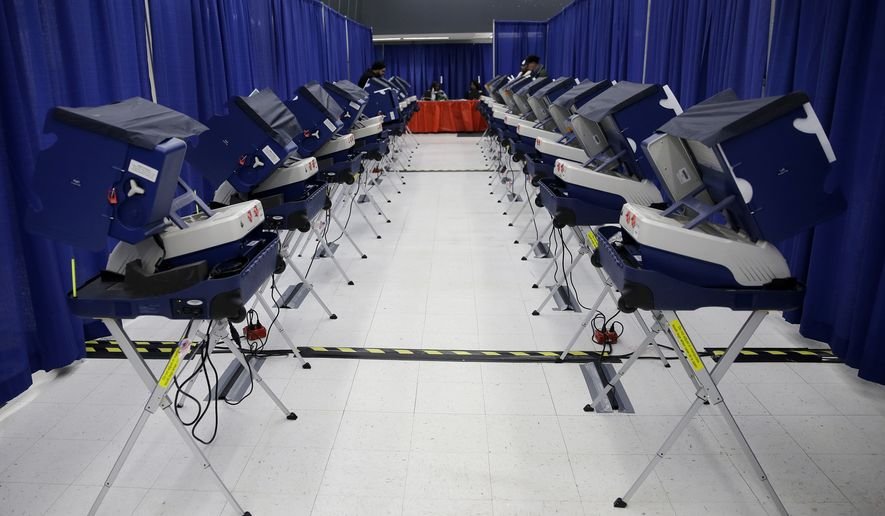 In this March 13, 2018, file photo, voters cast their ballots in Illinois primary elections at the city's new early voting super site in downtown Chicago. (AP Photo/Kiichiro Sato, File)