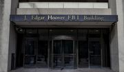 In this March 4, 2019, file photo, the J. Edgar Hoover FBI Building is seen in Washington. (AP Photo/Alex Brandon, File) **FILE**