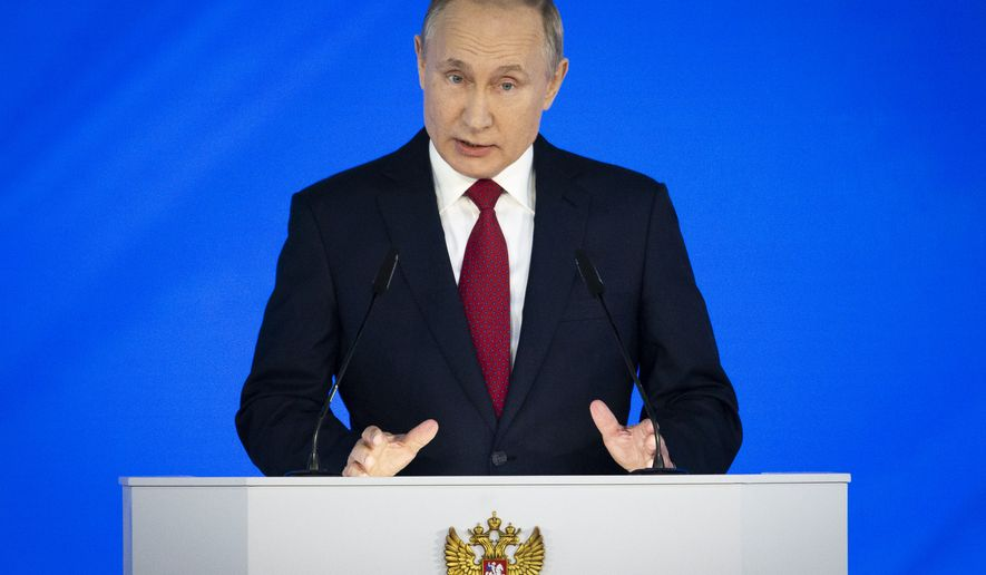 Russian President Vladimir Putin addresses the State Council in Moscow, Russia, Wednesday, Jan. 15, 2020.Putin proposed changing the Russian Constitution to increase the powers of parliament and the Cabinet. (AP Photo/Alexander Zemlianichenko)