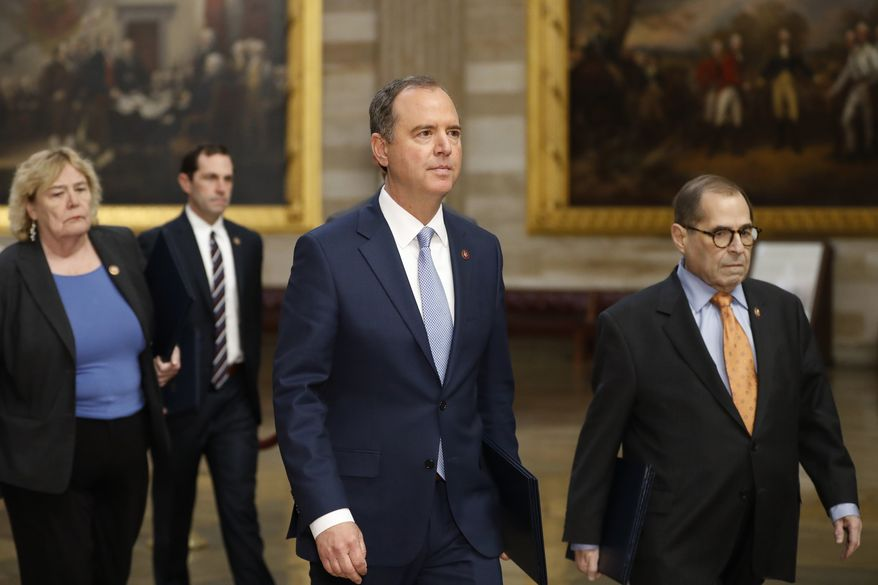 Impeachment managers, House Judiciary Committee Chairman, Rep. Jerrold Nadler, D-N.Y., right, and House Intelligence Committee Chairman Adam Schiff, D-Calif., center, lead as D-Fla., Rep. Zoe Lofgren, D-Calif., and Rep. Jason Crow, D-Colo., follow as they walk through the rotunda on their way to the Senate on Capitol Hill in Washington, Thursday, Jan. 16, 2020. (AP Photo/Julio Cortez)