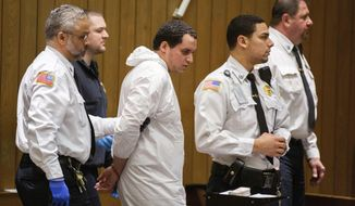 Miguel Rodriguez, who is being charged with abducting an 11-year-old girl, is arraigned in Springfield District Court, Thursday, Jan. 16, 2020, in Springfield, Mass. (Leon Nguyen/The Republican via AP, Pool)