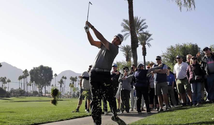 Phil Mickelson hits from the rough on the fourth hole during the first round of The American Express golf tournament at La Quinta Country Club Thursday, Jan. 16, 2020, in La Quinta, Calif. (AP Photo/Marcio Jose Sanchez)
