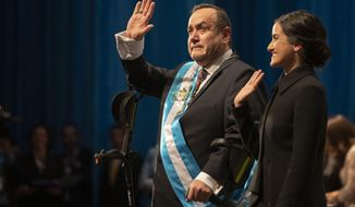 Alejandro Giammattei waves to the crowd accompanied by his daughter Ana Marcela after he was sworn-in as president of Guatemala at the National Theater in Guatemala City, Tuesday, Jan. 14, 2020. Guatemala swears in Giammattei, a conservative physician opposed to gay marriage and abortion, as its new president Tuesday while the country's outgoing leader exits amid swirling corruption accusations. (AP Photo/Moises Castillo)