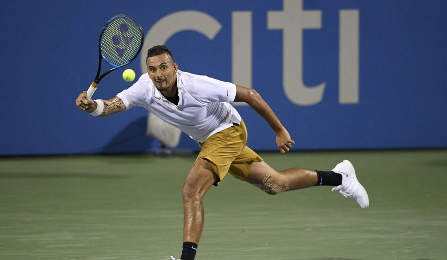 In this Aug. 2, 2019, file photo, Nick Kyrgios, of Australia, returns the ball to Norbert Gombos, of Slovakia, during the Citi Open tennis tournament in Washington. Kyrgios will be competing in the Australian Open tennis tournament beginning Monday, Jan. 20, 2020. (AP Photo/Nick Wass, File) **FILE**