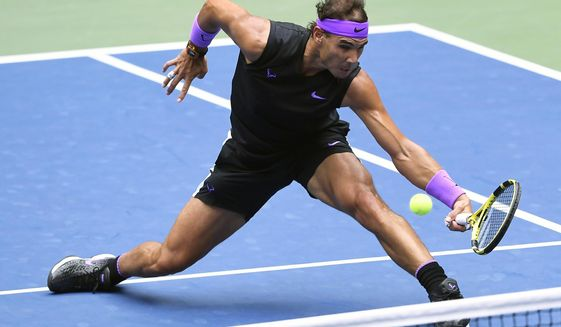 FILE - In this Sept. 8, 2019, file photo, Rafael Nadal, of Spain, returns a shot to Daniil Medvedev, of Russia, during the men's singles final of the U.S. Open tennis championships in New York. Nadal will compete in the Australian Open tennis tournament beginning Monday, Jan. 20, 2020. (AP Photo/Sarah Stier, File)