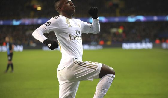 Real Madrid's Vinicius Junior jubilates after scoring his sides second goal during the Champions League group A soccer match between Brugge and Real Madrid at the Jan Breydel stadium in Bruges, Belgium, Wednesday, Dec. 11, 2019. (AP Photo/Francisco Seco)
