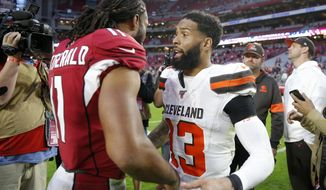 Arizona Cardinals wide receiver Larry Fitzgerald greets Cleveland Browns wide receiver Odell Beckham (13) after an NFL football game, Sunday, Dec. 15, 2019, in Glendale, Ariz. The Cardinals won 38-24. (AP Photo/Rick Scuteri)