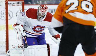 Montreal Canadiens' Carey Price, left, blocks a shot past Philadelphia Flyers' Claude Giroux during the second period of an NHL hockey game, Thursday, Jan. 16, 2020, in Philadelphia. (AP Photo/Matt Slocum)