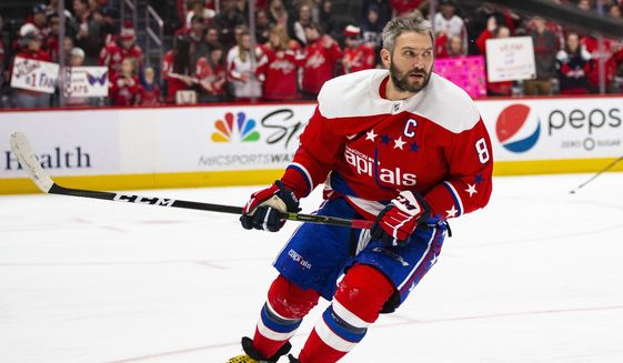 Washington Capitals left wing Alex Ovechkin (8), from Russia, skates during warmups before an NHL hockey game against the New Jersey Devils, Thursday, Jan. 16, 2020, in Washington. (AP Photo/Al Drago) ** FILE **