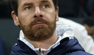 Marseille's head coach Andre Villas-Boas looks out before the League One soccer match between Rennes and Marseille, at the Roazhon Park stadium in Rennes, France, Friday, Jan. 10, 2020. (AP Photo/David Vincent)