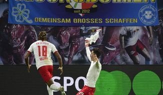 Leipzig's Patrik Schick, right, celebrates after scoring a goal during the German Bundesliga soccer match between RB Leipzig and FC Augsburg in Leipzig, Germany, Saturday, Dec. 21, 2019. (AP Photo/Jens Meyer)
