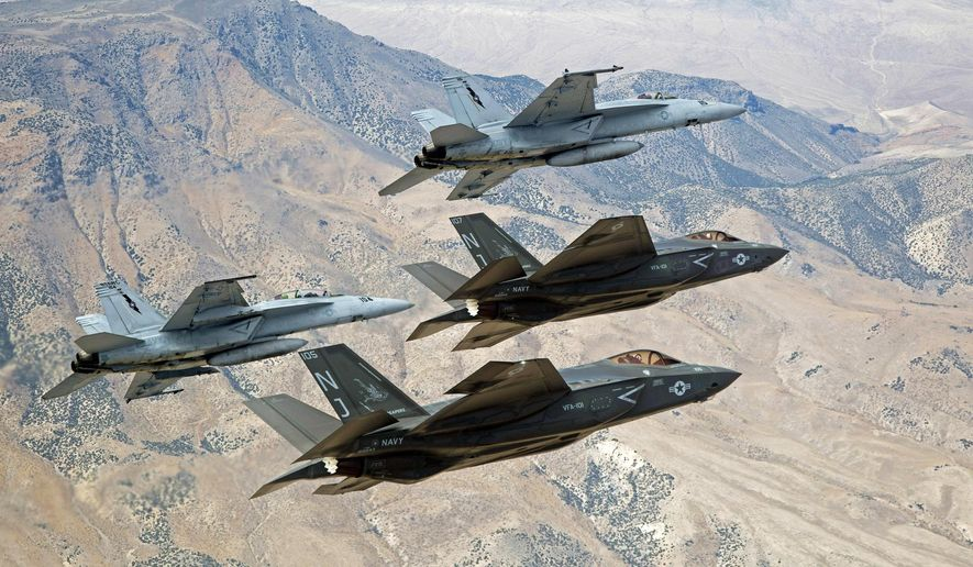 F-35C Lightning IIs, attached to the Grim Reapers of Strike Fighter Squadron (VFA) 101, and F/A-18E/F Super Hornets attached to the Naval Aviation Warfighter Development Center (NAWDC) fly over Naval Air Station Fallon's (NASF) Range Training Complex near Fallon, Nevada, Sept. 3, 2015. (Lt. Cmdr. Darin Russell/U.S. Navy via AP) ** FILE **