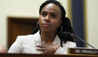 FILE - This July 10, 2019 file photo shows Rep. Ayanna Pressley, D-Mass., at the House Financial Services Committee on Capitol Hill in Washington. Pressley, whose hair twists were an inspiration to young girls and part of her personal identity and political brand, revealed Thursday, Jan. 16, 2020, that she has gone bald due to alopecia. The freshman Massachusetts' Democrat made a touching video for The Root, the African American-focused online magazine, in which she revealed her bald head. (AP Photo/Susan Walsh, File)