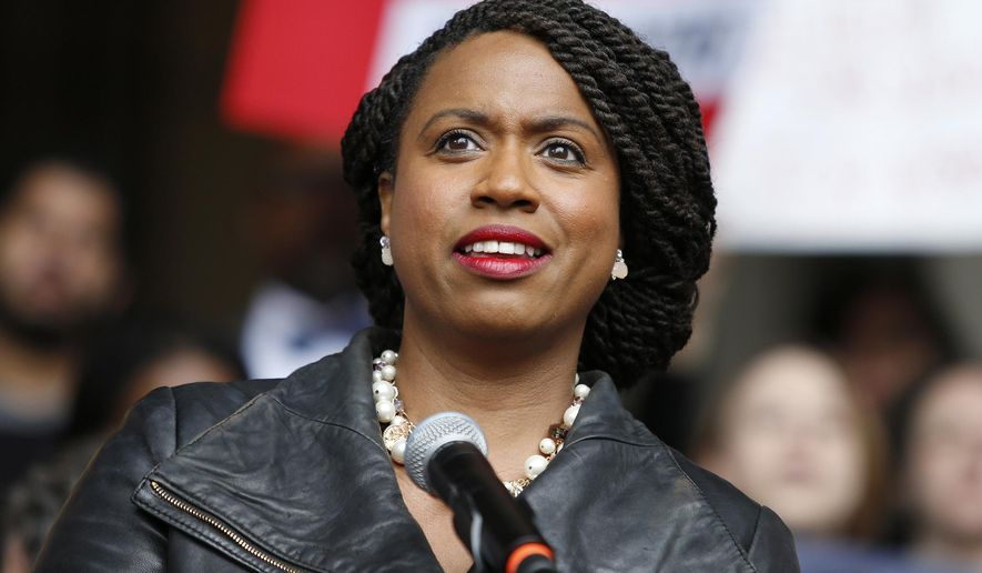 In this Oct. 1, 2018, file photo, then-Boston City Councilor Ayanna Pressley speaks at a rally at City Hall in Boston. (AP Photo/Mary Schwalm, File)