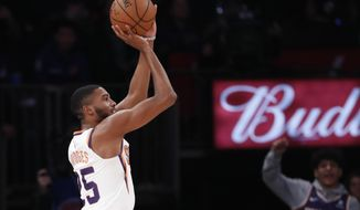 Phoenix Suns forward Mikal Bridges (25) shoots for three points with no visible New York Knicks defense during the first half of an NBA basketball game in New York, Thursday, Jan. 16, 2020. (AP Photo/Kathy Willens)