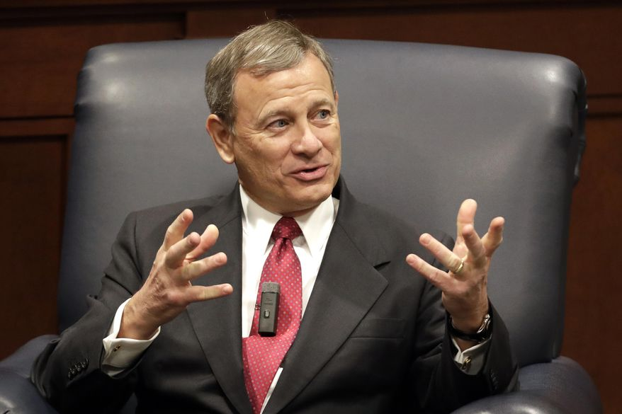 In this Feb. 6, 2019, file photo, Supreme Court Chief Justice John Roberts answers questions during an appearance at Belmont University in Nashville, Tenn. (AP Photo/Mark Humphrey, File)