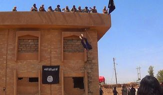 In this photo released on January 14, 2015, by a militant website, which has been verified and is consistent with other AP reporting, Islamic State militants kill a man they accused of being a homosexual by throwing him off a building in Syria's northeastern province of Hassakeh.   The Washington-based Syria Justice and Accountability Center, a U.S.-based Syrian rights group, said Thursday, Jan. 16, 2020,  that evidence, documents produced by the Islamic State militants themselves,  could help identify individuals responsible for atrocities during the militants four-year reign of terror in Syria, thus enabling prosecution for international crimes. (Militant website via AP)