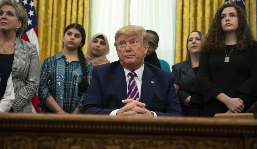 President Donald Trump listens to a question during an event on prayer in public schools, in the Oval Office of the White House, Thursday, Jan. 16, 2020, in Washington. (AP Photo/ Evan Vucci)