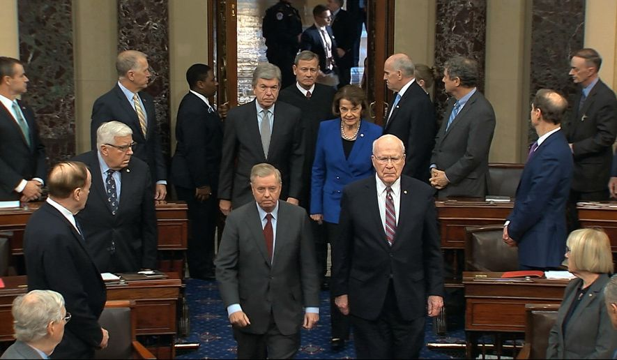 In this image from video, Sen. Lindsey Graham, R-S.C., left, Sen. Patrick Leahy, D-Vt., Sen. Dianne Feinstein, D-Calif., and Sen. Roy Blunt, R-Mo., escort Supreme Court Chief Justice John Roberts into the Senate chamber in the Senate at the U.S. Capitol in Washington, Thursday, Jan. 16, 2020. (Senate Television via AP)
