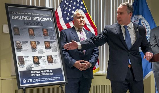 """Matthew Albence, right, the acting director of U.S. Immigration and Customs Enforcement, speaks during a news conference, Friday, Jan. 17, 2020, in New York. The country's top immigration official blamed the """"sanctuary policies"""" of New York City on Friday for the sexual assault and killing of a 92-year-old woman, while the mayor's office decried such rhetoric as """"fear, hate and attempts to divide."""" (AP Photo/Jim Mustian)"""