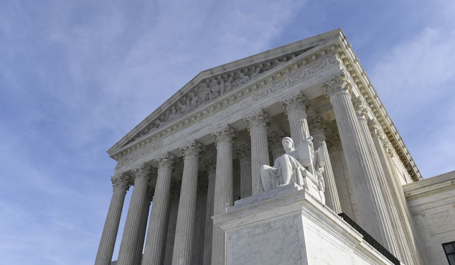 In this Nov. 11, 2019, photo, a view of the Supreme Court in Washington.  The Supreme Court will decide whether Electoral College voters are required to support presidential candidate who wins their state. (AP Photo/Susan Walsh) **FILE**