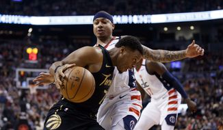 Toronto Raptors guard Kyle Lowry (7) drives against Washington Wizards guard Isaiah Thomas during the first half of an NBA basketball game Friday, Jan. 17, 2020, in Toronto. (Cole Burston/The Canadian Press via AP)