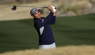 Rickie Fowler follows through on his shot from the 10th fairway during the second round of The American Express golf tournament on the Nicklaus Tournament Course at PGA West on Friday, Jan. 17, 2020, in La Quinta, Calif. (AP Photo/Marcio Jose Sanchez)