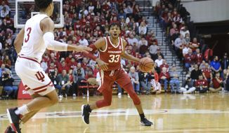 Arkansas guard Jimmy Whitt Jr. (33) brings the ball upcourt in front of Indiana forward Justin Smith (3) in the second half of an NCAA college basketball game in Bloomington, Ind., Sunday, Dec. 29, 2019. (AP Photo/AJ Mast)