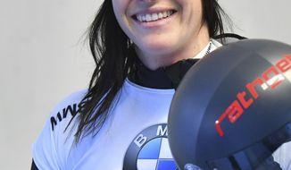 Austria's second placed Janine Flock in the finish area after the women's Skeleton World Cup race in Igls, near Innsbruck, Austria, Friday, Jan. 17, 2020. (AP Photo/Kerstin Joensson)