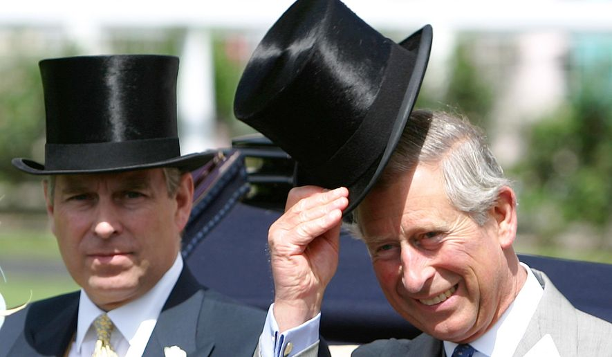 FILE - In this Wednesday June 21, 2006 file photo, Britain's Prince Charles, right with is brother the Prince Andrew the Duke of York as they arrive in the paddock for the Royal Ascot horse race meeting, Ascot, England. Prince Charles has long been seen as a potential modernizer who wants a more modest monarchy in line with other European royal households - and the streamlining process has already begun with the astounding developments of recent months. But the changes have come at a terrible cost for Charles, who has seen his brother Prince Andrew disgraced and his once close sons Prince William and Prince Harry become estranged. (AP Photo/Alastair Grant, File)